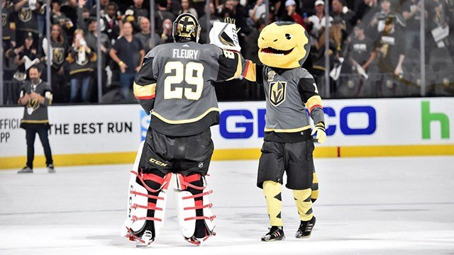 Golden Knights goalie Marc-Andre Fleury gives mascot Chance a high-five in this undated photo. (Photo: Vegas Golden Knights)