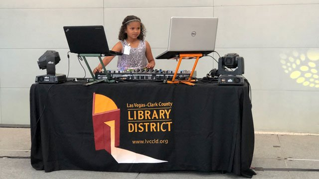 A young DJ mixed electronic dance music at McCarran Airport on May 17, 2018. (Dylan Kendrick/FOX5)