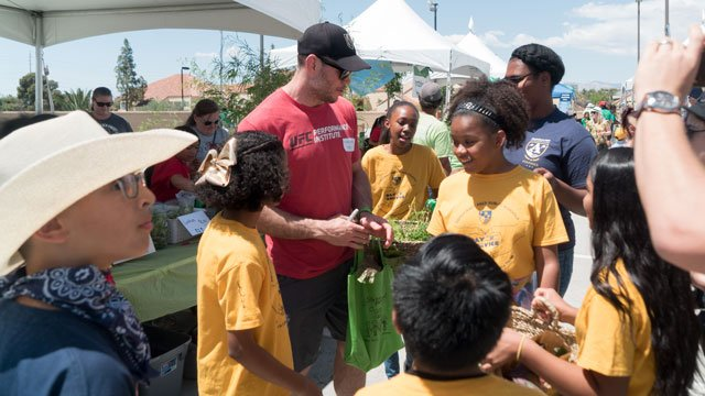 Students raised nearly $9,000 at a student-run farmers market in Las Vegas. (Source: Green Our Planet)