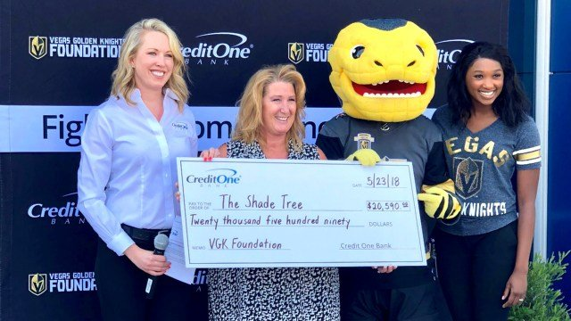 Members of The Shade Tree receiving a donation from Credit One Bank and the Vegas Golden Knights Foundation. (Photo: Credit One Bank)