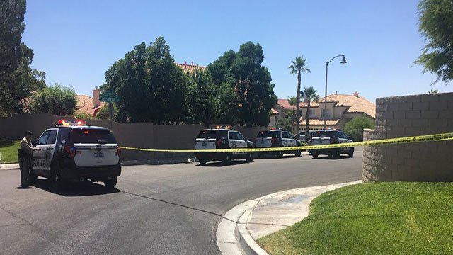 LVMPD patrol units block the entrance of a west Valley neighborhood as they investigate a shooting (Cherney Amhara / FOX5).