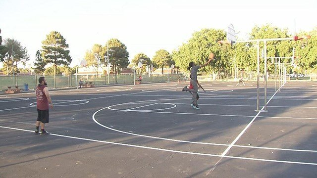 New blacktop and lines on Sunset Park's 16-hoop basketball court have made it safer and easier to play there. (Roger Bryner / FOX5)