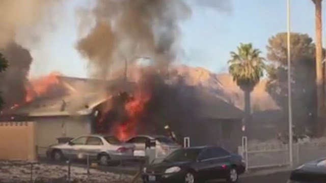Firefighters battled flames that spread to three homes near Lamb and Charleston Boulevards Monday, according to Las Vegas Fire and Rescue. (Photo: Jeff Cuneo)