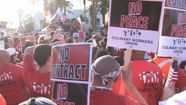 Casino workers hold up signs as they fight for a new deal. (FOX5)