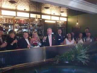 Former Las Vegas Mayor Oscar Goodman raises a toast to the wedded Mob Museum couples at Mob Bar. (Peter Dawson/FOX5)