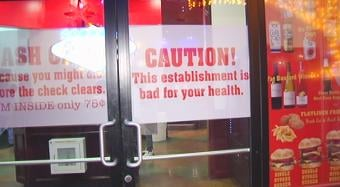 The restaurant displays a health warning on its doors