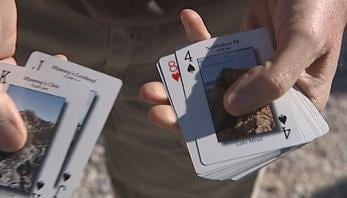 Cards are collected after reaching each of the 52 peaks