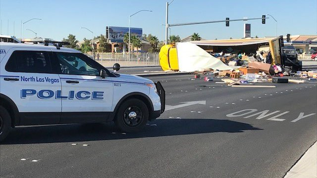 A moving truck rolled over and spilled debris on N Decatur Blvd. (Photo: Brad Boyer/FOX5)