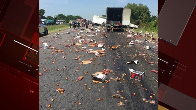 Two tractor-trailers collided Thursday on Interstate 40 in central Arkansas, causing one to spill hundreds of mini-bottles of the cinnamon-flavored whiskey on the highway. (Photo: Arkansas DOT)