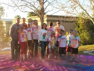 FOX5's Heidi Hayes poses with volunteers and participants of the Color Run.