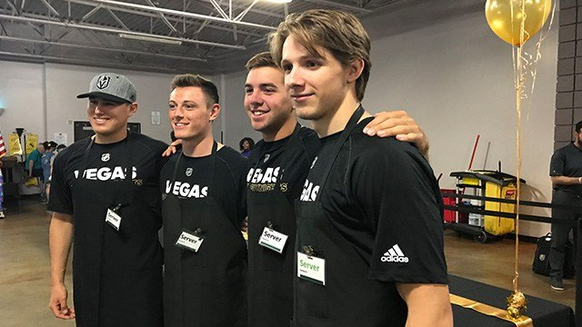 Serving food and serving hope, Golden Knights prospects put away the pucks and picked up the plates for more than 1,000 clients of Catholic Charities of Southern Nevada. (Robbie Hunt / FOX5)