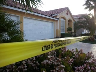 Police tape off a home where two bodies were found early Wednesday. (Courtesy: Armando Navarro)