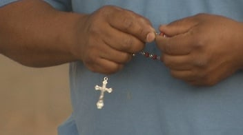 Friends and family prayed the rosary during the vigil