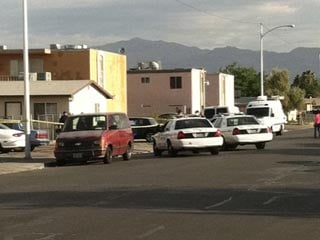 Police cars are parked outside a residence where four people were shot Thursday. (Stefanie Jay/FOX5)