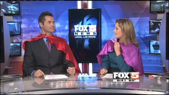 Dave Hall and Heidi Hayes donned their custom-made capes on Friday.