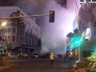 A cloud of dust followed the implosion of the O'Sheas parking garage early Tuesday. (Dave Lawrence/FOX5)