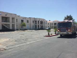 A fire truck parked outside the charred apartment complex. (Courtesy: Les Krifaton/FOX5)