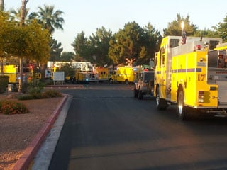 Fire trucks line an entrance to the Garden Park Townhomes early Wednesday morning. (Dave Lawrence/FOX5)