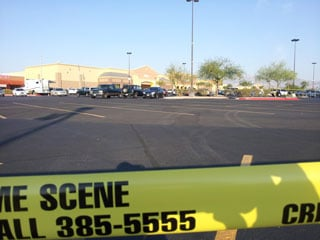 Crime tape cordons off the parking lot of the Wal-Mart where officers confronted an armed theft suspect in Sept. 2011. (Armando Navarro/FOX5)