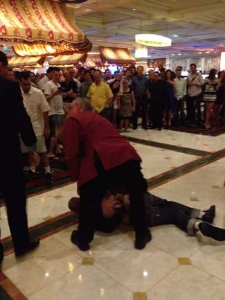 One of the heist suspects is held to the ground after the robbery. (Courtesy of witness Brad Jackson)