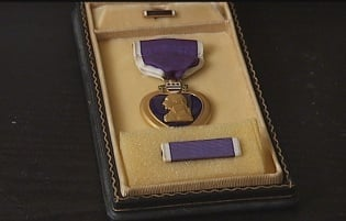 Janet's daughter will present her with a pin from Col. Lewis's Purple Heart