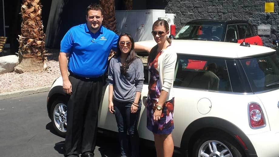 Navarro, center, with her new car. (Justin Grant/FOX5)