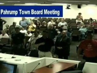 Carns (center, dark shirt) announced his intention to arrest three Pahrump Town Board members. (KVMP-TV)