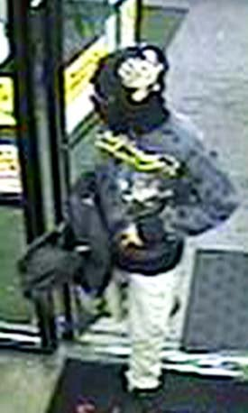The armed robber was wearing a gray jacket, tan pants and black shoes. (LVMPD)