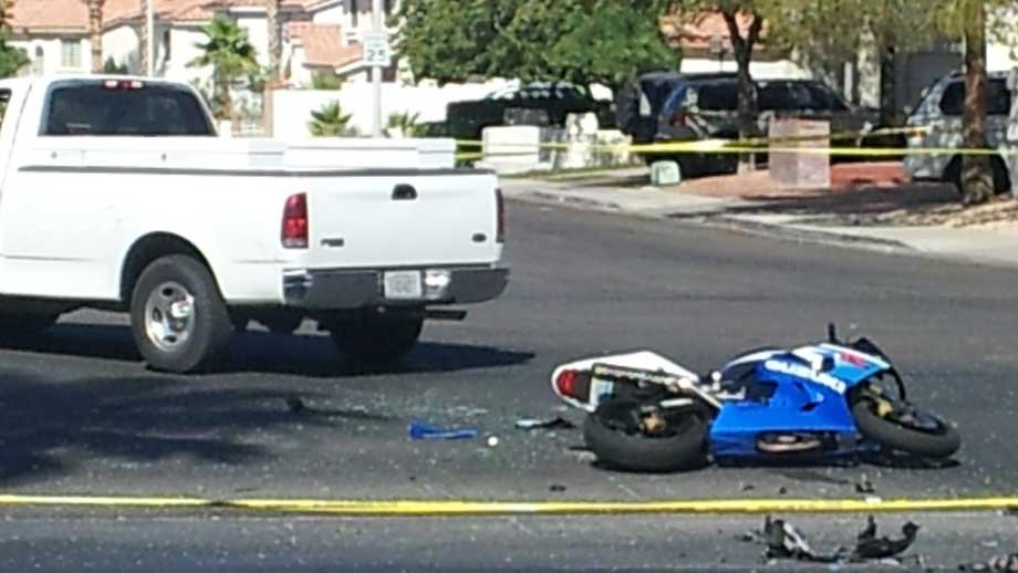A motorcycle lays in the ground after a collision with a City of Henderson truck. (Peter Dawson/FOX5)