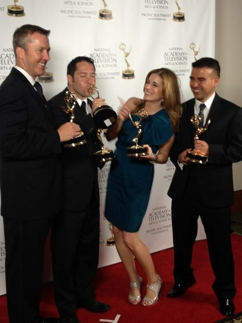 (from l-r) FOX5's John Huck, Matt DeLucia, Elizabeth Watts and Christian Cazares hold Emmy statues won in San Diego.