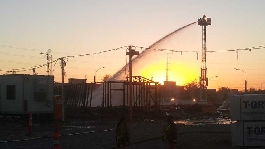 Firefighters spray water on remaining hot spots after the fire. (Peter Dawson/FOX5)
