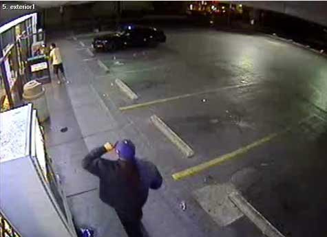 Newly released video shows the suspect approaching two victims at a 7-Eleven in May. (YouTube/LVMPD)