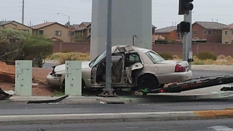 A vehicle is damaged after striking a pole in North Las Vegas. (Eric Youngman/FOX5)
