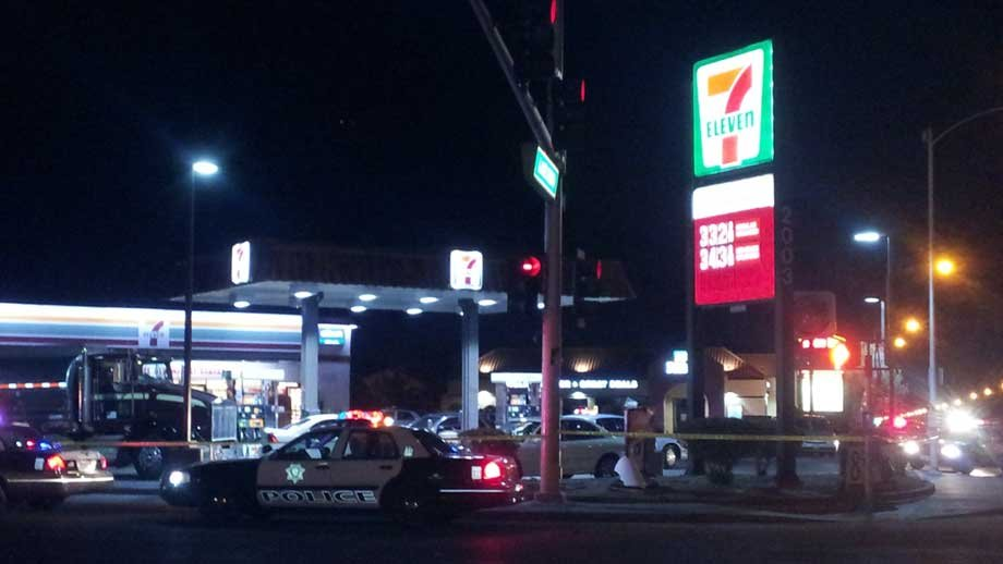 Police cars line a street near a 7-Eleven where a robbery suspect was shot. (Armando Navarro/FOX5)