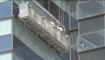 Fire personnel were called to rescue the trapped window washers. (Jason Valle/FOX5)