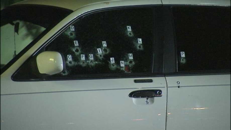 Bullet holes riddle a vehicle where a woman was wounded. (Armando Navarro/FOX5)