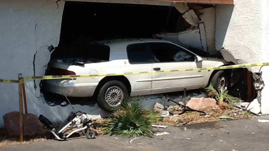 A car plowed into the wall of an office building on Jones Boulevard on Aug. 14, 2012. (CCFD)