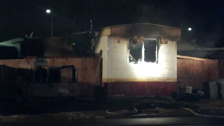 A mobile home was destroyed by a fire near Vegas Valley and Nellis. (Armando Navarro/FOX5)