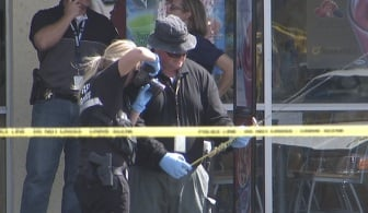 Investigators examine the sword used in the robbery attempt Sunday afternoon. (Arron Healy/FOX5)