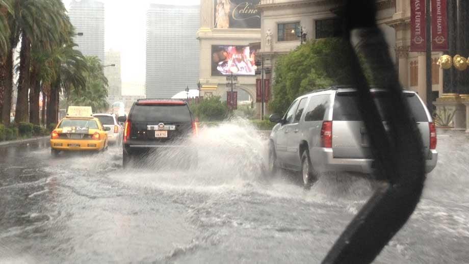 Vehicles dredged through standing water on the Las Vegas Strip. (Rolando Sanglay)
