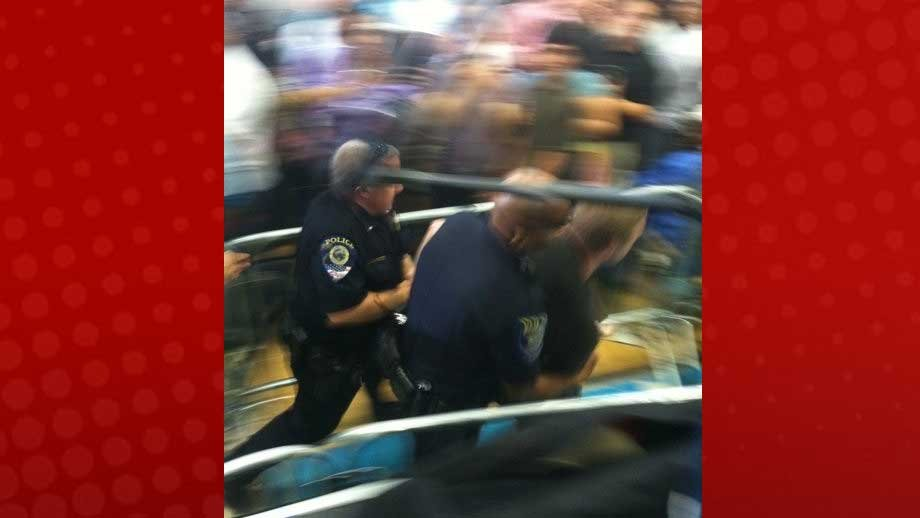 A heckler was removed from an Obama campaign event in NLV Wednesday. (Stefanie Jay FOX5)