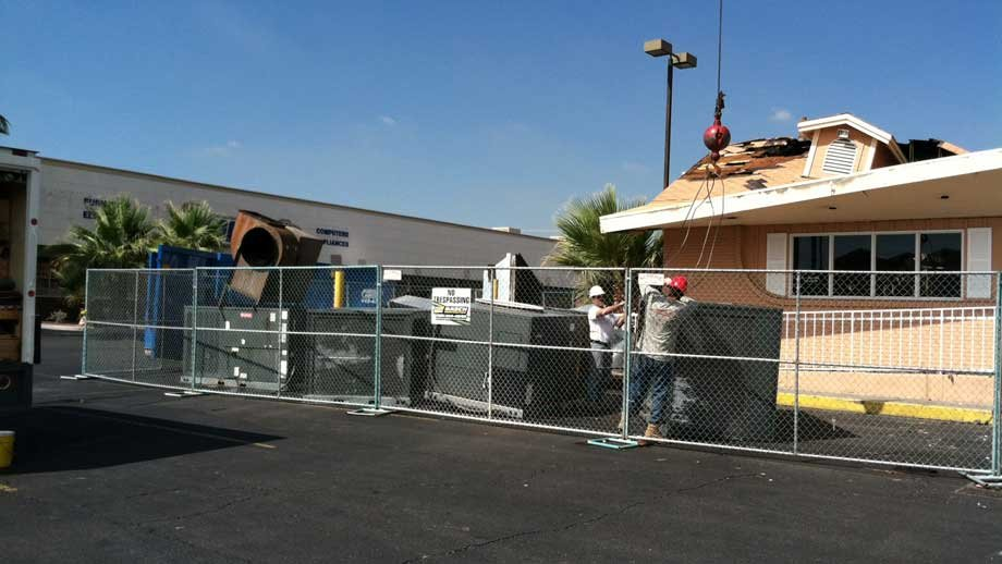 A crane was used to lift an outdoor air conditioning unit from the rooftop of the damaged Original Pancake House. (Las Vegas Fire and Rescue)