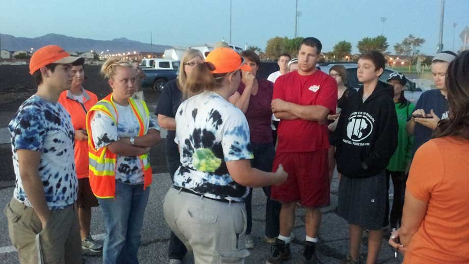Friends and family members of a teen who was feared to be swept away in the Pittman Wash gather before search resumed Thursday.(Dave Lawrence/FOX5)
