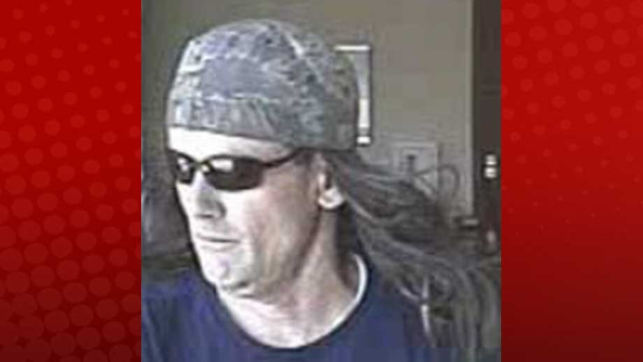 Surveillance photo of suspect wanted in connection to Vegas bank robbery Friday (Photo from LVMPD)