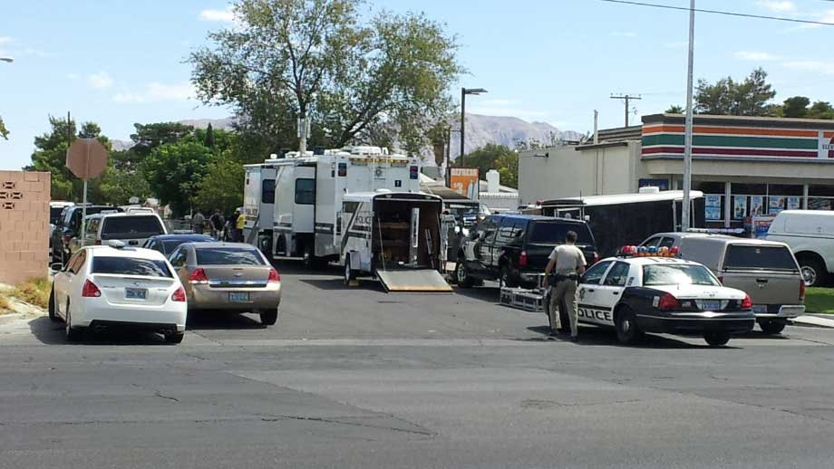 Police block a street where a man barricaded himself from police. (Joe Lybarger/FOX5)