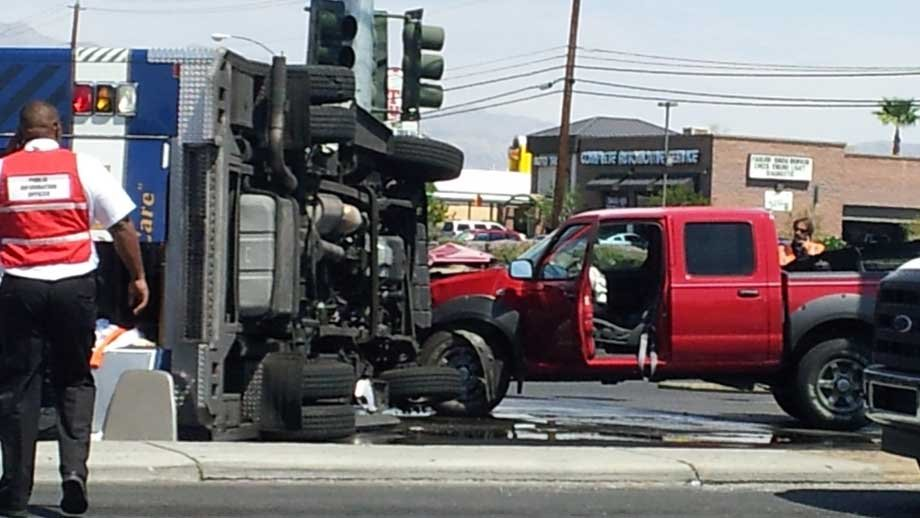 A Medic West ambulance rolled onto it side after a collision on Sept.. 4. (Jason Valle/FOX5)
