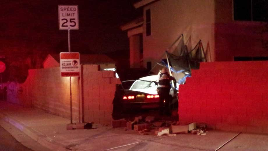 Police said three suspected robbers fled after crashing into a neighborhood wall. (Eric Youngman/FOX5)