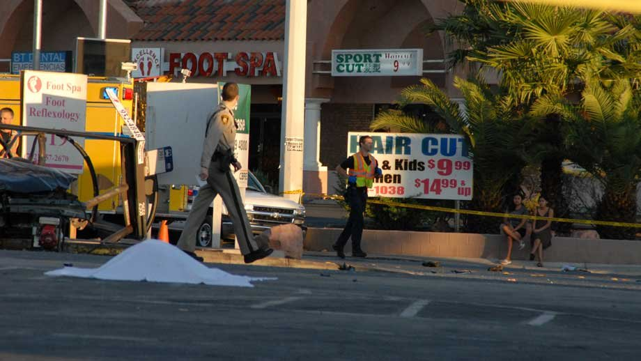 A sheet covers a body after a deadly wreck on Spring Mountain Road on Sept. 13, 2012. (Photo courtesy: James Atencio)