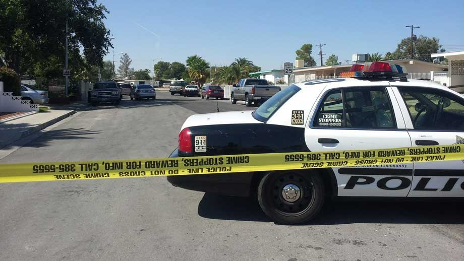 Police taped off a neighborhood in east Las Vegas after a person was found dead. (Christian Cazares/FOX5)