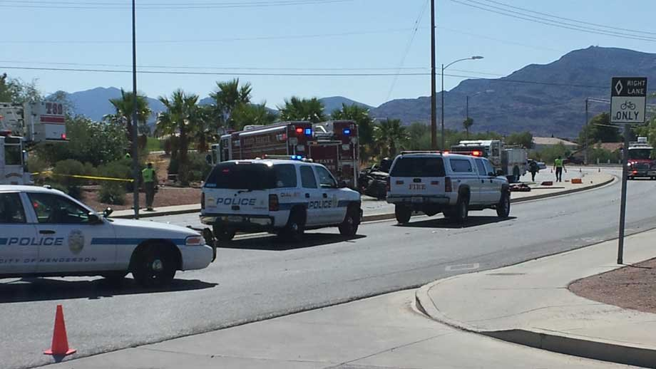 Emergency workers respond to a car rollover and fire in Henderson. (Doug Johnson/FOX5)